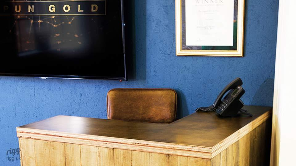 Brass & Plywood Reception Desk at TV Production Company Spun Gold
