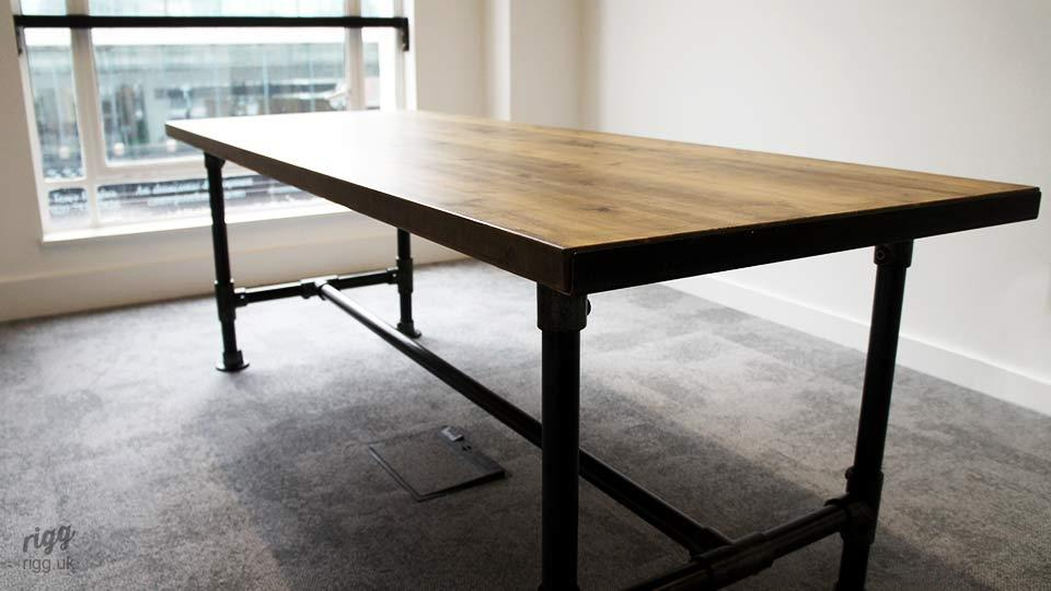 Wood Top Table with Tube Legs in Meeting Room