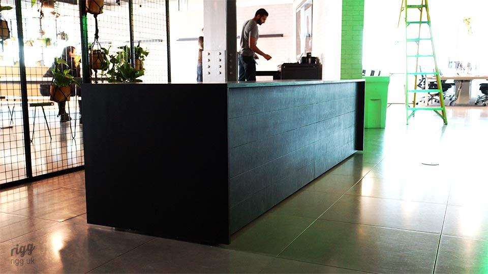 Black Plywood Office Reception Desk in Digital Agency