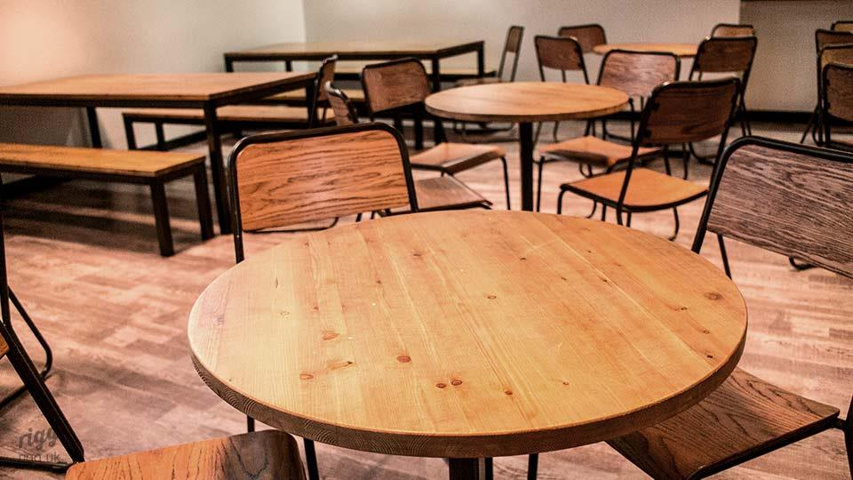 Round Wooden Bistro Cafe Tables in School Canteen
