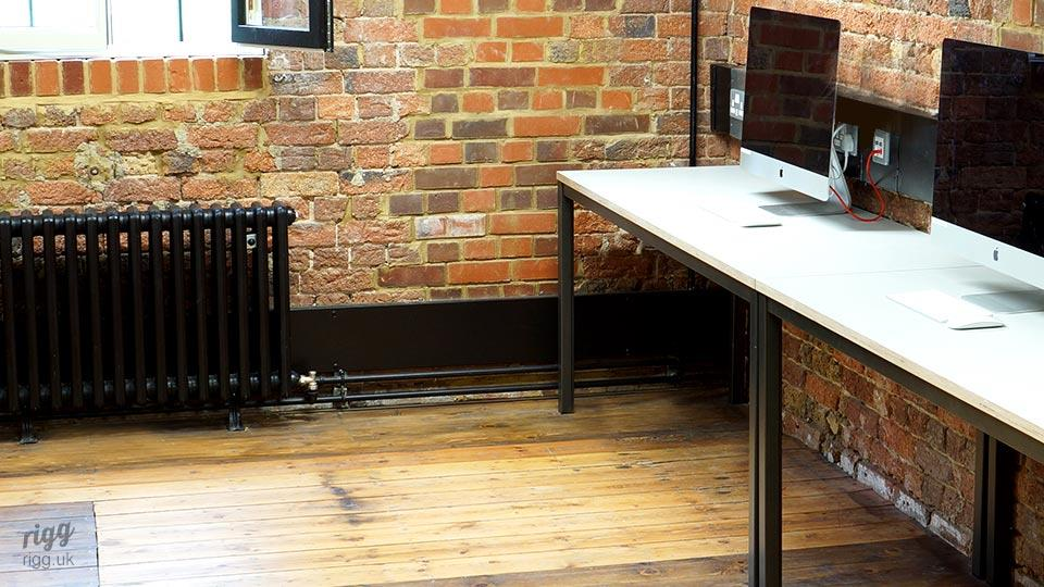 Plywood & White HPL Bench Desking Along Wall in Classroom