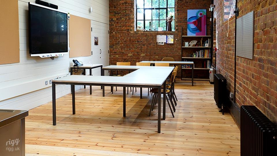 U Shaped Desk Layout and Shelving in Teaching Space with Large Interactive Screen