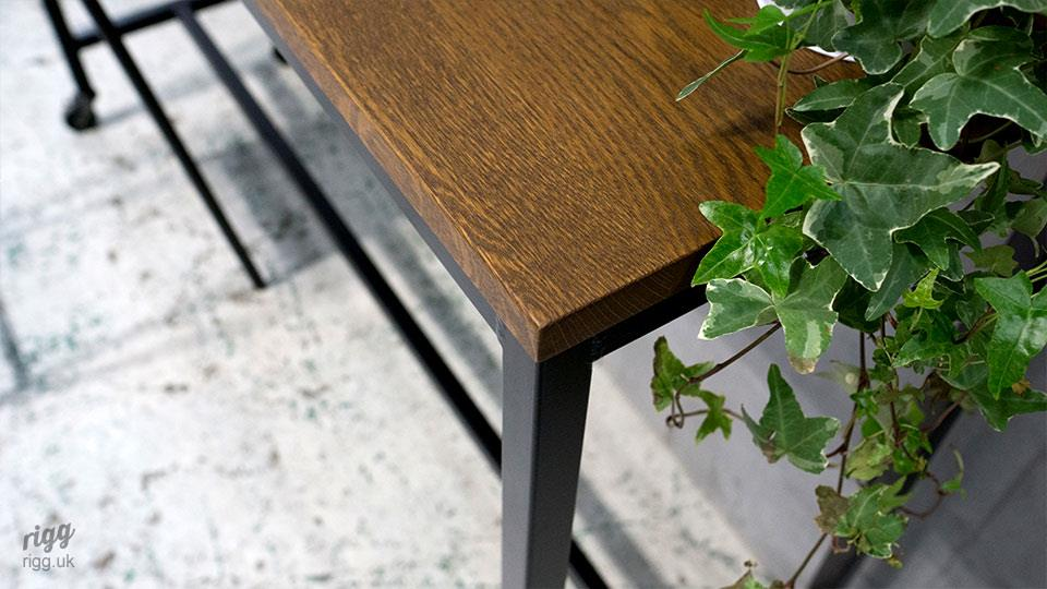 Solid oak table top, dark stained, close-up detail