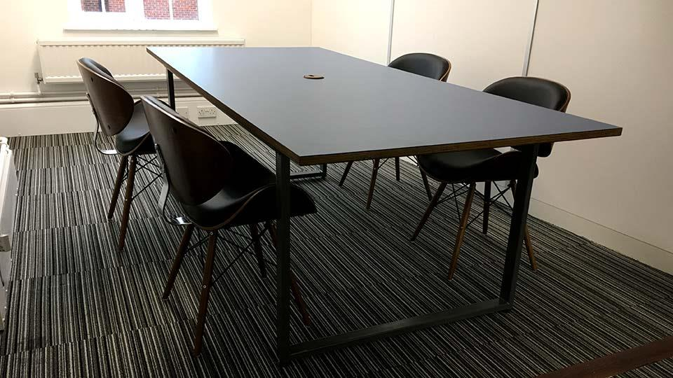 Loop Table with Cable Grommet in Office
