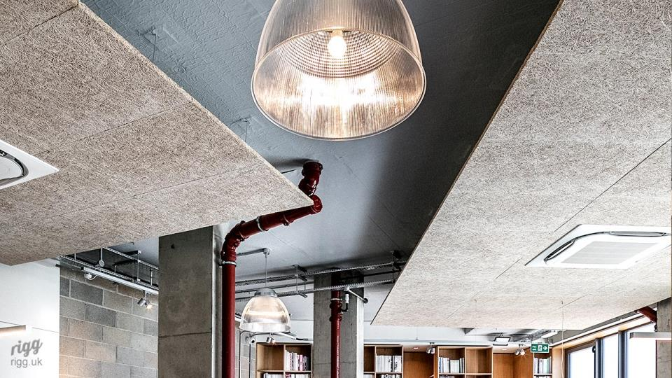 Exposed Raw Concrete Office with Industrial Glass Lighting - Dalston, London